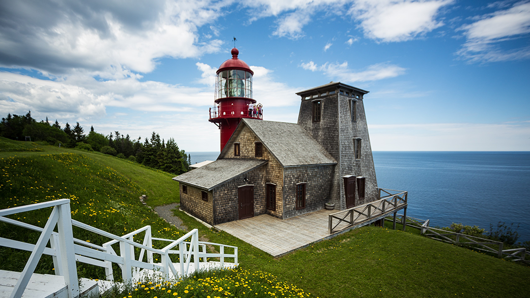Fame Point lighthouse under clouds in Gaspesie
